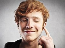 Medium rsz red haired man smiling while listening to music