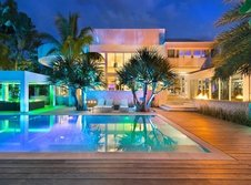 Medium rsz high end luxurious modern mansion with colorful lighting at night located in miami homesthetics florida 1